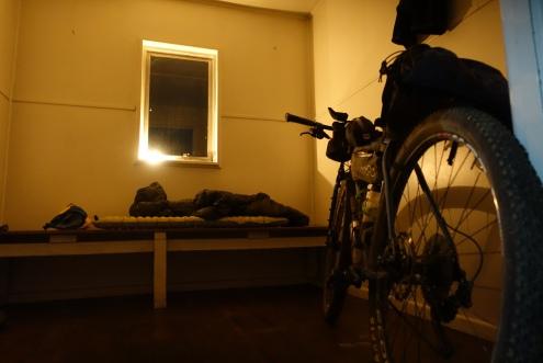 My room in Derschko's hut lit by candle light
